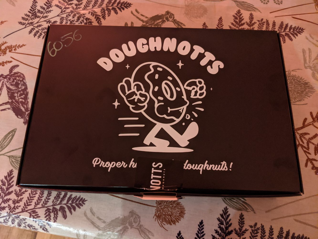 The Doughnotts packaging, with an anthropomorphised doughnut walking and smiling